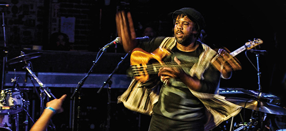 Bass player Victor Wooten performs onstage in this undated publicity photo.
