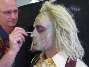 Steve LaPorta adds special effects makeup to what appears to be a Beatlejuice actor in this undated file photo