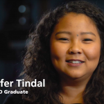screen shot of jennifer tindel from the video. It's a portrait-like head-and-shoulders shot with her name in the bottom left corner of the screen.