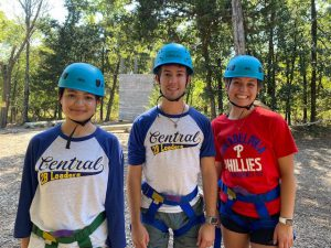 Three 2BLeaders students smiling for a photo after completing the ropes course.