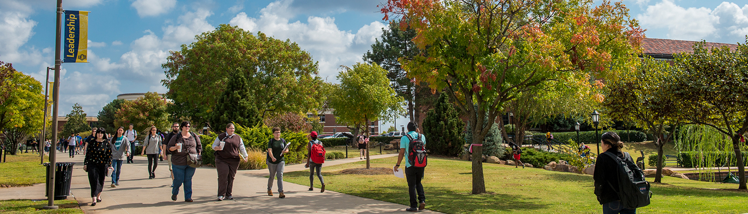 UCO campus with students walking on sidewalk