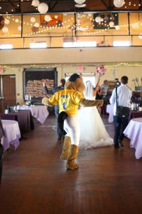 Buddy Broncho dancing at a wedding.