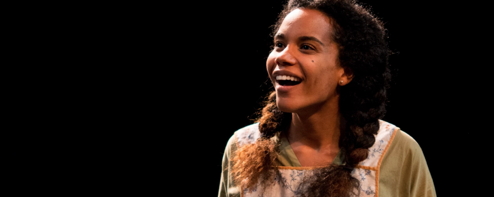 """Onstage as Rose in """"Dancing at Lughnasa,"""" Shellie Sterling smiles at the audience."""