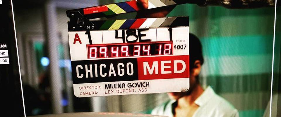 "Clapboard for ""Chicago Med"" showing Milena Govich as the episode's director."