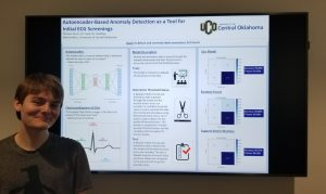 Thomas Dunn with research poster.