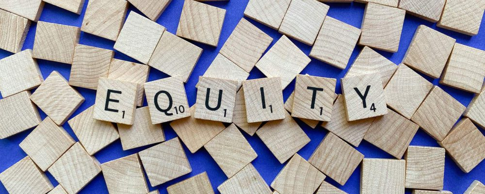 scrabble tiles spelling the word equity