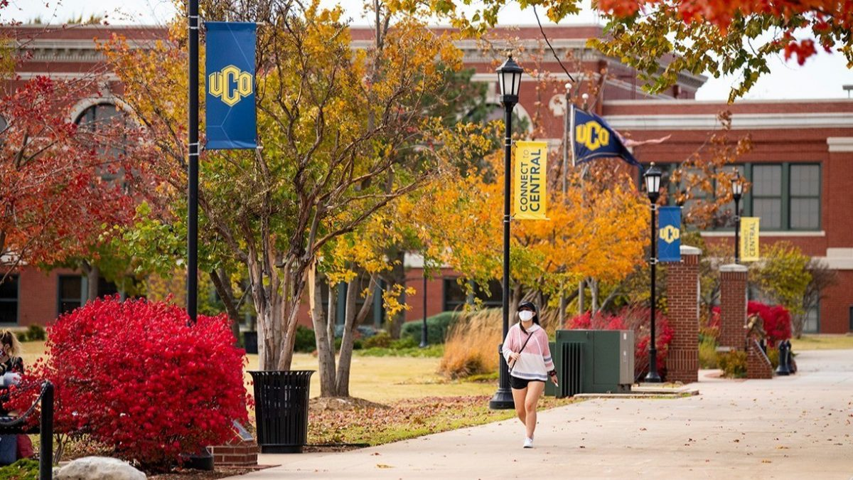 Photo of a student walking on campus during fall weather