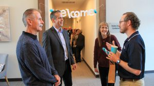 photo of Charles Gosset with Mark Walvoord and other guests at his office opening event