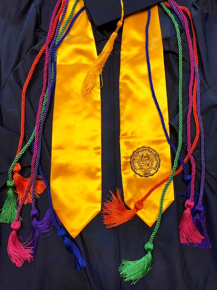 Photo of STLR graduate cords and robe