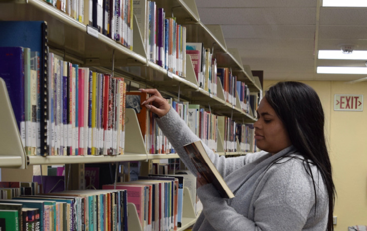 photo of Amanda at The Center's library section