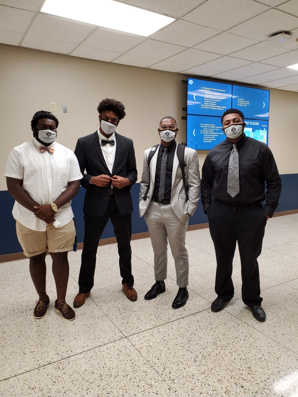 Photo of 4 students, in Covid masks, at UCO