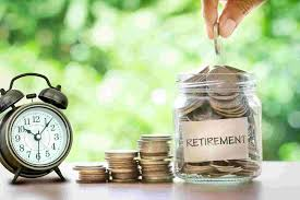 """Saving for retirement - a picture of a clock next to coins stacking up next to a glass jar labeled """"Retirement"""""""