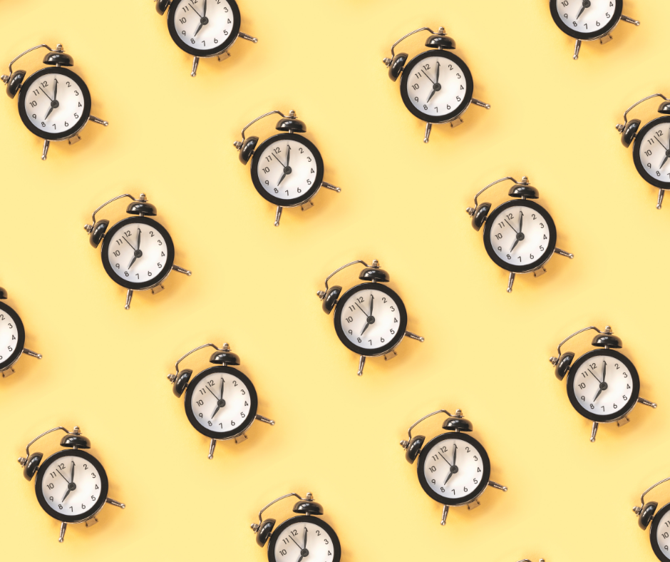 series of clocks on a yellow background