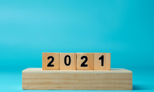 wooden cubes with numbers 2021 on a blue background. symbol of the new year. new year 2021