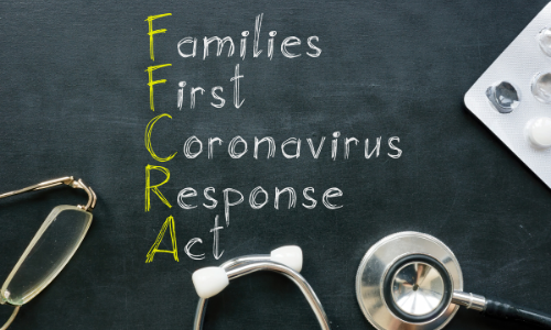 """chalkboard saying """"families first coronavirus response act"""" with medical supplies"""