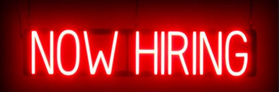 "neon sign saying ""now hiring"""