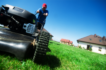 man mowing lawn in the sun
