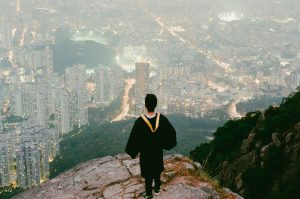 Graduating student looking out over city